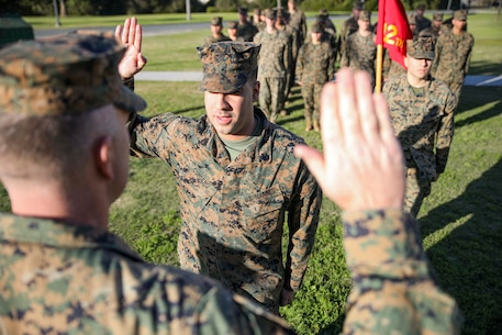 U.S. Marine Corps Staff Sgt. Jeffrey Cordero is sworn in by the Commanding Officer of 12th Marine Corps District, Colonel James B. Conway, during his reenlistment ceremony aboard Marine Corps Recruit Depot San Diego, Calif., on December 19, 2019. Nine years ago, then Corporal Jeffrey Cordero was sworn into the Marine Corps by Colonel Conway's father, and 34th Commandant of the Marine Corps, General James T. Conway, during his reenlistment ceremony at the 9th Marine Corps District Headquarters in Kansas City, Mo., on Aug. 29, 2010. Staff Sgt. Jeffrey Cordero is the Communications Strategy and Operations Chief at 12th Marine Corps District, and is from New York City, N.Y.
