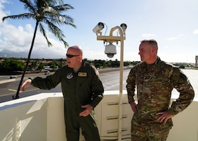 Chief Master Sgt. David Wolfe, 11th Air Force Command Chief Master Sgt., tours the crow's nest with Chief Master Sgt. Mark Henriquez, 15th Operations Group Superintendent, on Joint Base Pearl Harbor-Hickam, Hawaii, Dec. 18, 2019. In 1941, when the base was attacked, the crow's nest survived because the attackers deemed it unimportant. (U.S. Air Force photo by Airman 1st Class Erin Baxter)