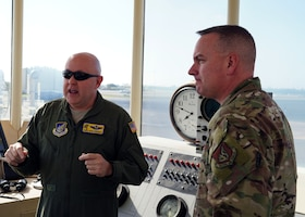 Chief Master Sgt. David Wolfe, 11th Air Force Command Chief Master Sgt., tours the crow's nest with Chief Master Sgt. Mark Henriquez, 15th Operations Group Superintendent, on Joint Base Pearl Harbor-Hickam, Hawaii, Dec. 18, 2019. The crow's nest is a historic landmark on base that survived the attack on the station in 1941. (U.S. Air Force photo by Airman 1st Class Erin Baxter)