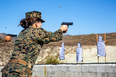 U.S. Navy Hospital Corpsman 1st Class Vilma Rudolph, a corpsman with the 13th Marine Expeditionary Unit Command Element, engages her target with an M9 pistol during a qualification range at Marine Corps Base Camp Pendleton, Calif., Nov. 26, 2019.