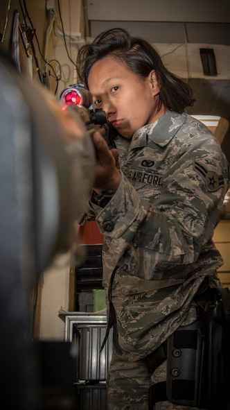 Airman 1st Class Jessica Carino, a 35th Security Forces Squadron armorer, ensures the M4 carbine assault rifle is clear and safe at Misawa Air Base, Japan, Dec. 18, 2019. Carino earned the Elizabeth N. Jacobson Award for Expeditionary Excellence, given for outstanding performance while deployed in Kunsan Air Base, South Korea. (U.S. Air Force photo by Airman 1st Class China M. Shock)
