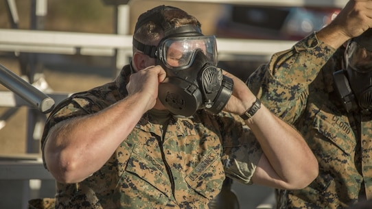 U.S. Marine Corps Master Sgt. Joshua R. Kirchem, a Marine with the 13th Marine Expeditionary Unit, I Marine Expeditionary Force, adjusts his M61 gas mask before the annual chemical, biological, radiological, and nuclear defense training at Marine Corps Base Camp Pendleton, Calif., October 24, 2019.