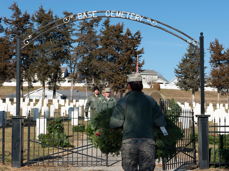 Members of Team Offutt carry wreaths to the base cemetery at Offutt Air Force Base, Neb., Dec. 11, 2019. The wreaths were placed at the end of each headstone row in preparation for an annual Wreaths Across America ceremony