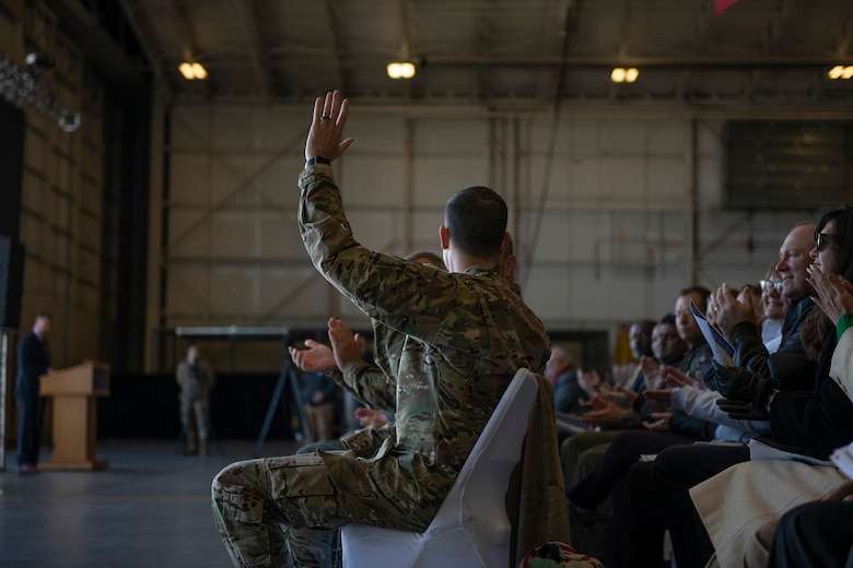 Col. Merrill waves at crowd.