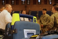 Members of the 33rd Civil Support Team brief Maj. Gen. Olivier Kim, Chief of the French Gendarmerie Reserves Command, at the District of Columbia National Guard's Armory Dec. 11.