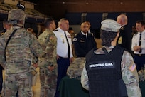 Members of the 372nd Military Police Battalion, known as the Red Hand, brief Maj. Gen. Olivier Kim, Chief of the French Gendarmerie Reserves Command, on their crucial role in conducting traffic control, corrections, security and mobility support, especially during National Special Security Events.