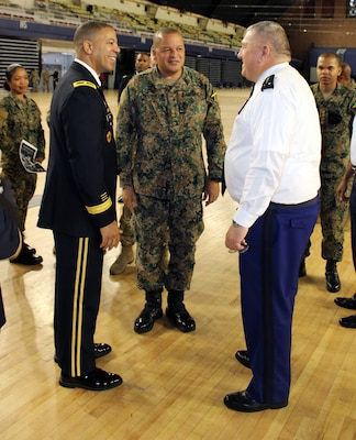 Brig. Gen. Aaron R. Dean, the Adjutant General of the District of Columbia National Guard, introduces Lt. Col. Sydney Powell, Jamaica Defence Force with the Health Services Corps, to Maj. Gen. Olivier Kim, Chief of the French Gendarmerie Reserves Command at the DCNG Armory Dec. 11.