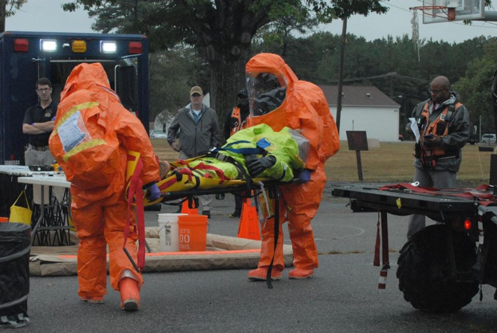 Members of the District of Columbia National Guard's 33rd Civil Support Team work rescue a simulated victim during recent Training Proficiency Evaluation at Fort Lee in Colonial Heights, Va.