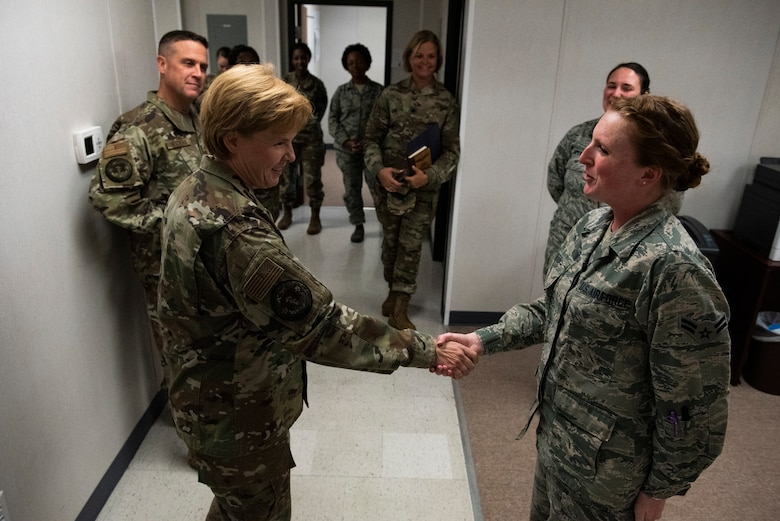 U.S. Air Force Brig. Gen. Sharon Bannister, Air Combat Command Surgeon General, left, coins Airman 1st Class Brittani Wattes, 325th Operational Medical Readiness Squadron family medicine technician, at Tyndall Air Force Base, Florida, Dec. 18, 2019. Bannister coined Watts for the airman's positive attitude, dedication to performing tasks and completing upgrade training in compliance with U.S. Air Force standards. (U.S. Air Force photo by Staff Sgt Magen M. Reeves)