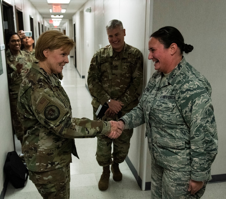 U.S. Air Force Brig. Gen. Sharon Bannister, Air Combat Command Surgeon General, left, coins U.S. Air Force Capt. Tanya Capper, 325th Operational Medical Readiness Squadron primary care flight commander, at Tyndall Air Force Base, Florida, Dec. 18, 2019. Capper was coined by Bannister for her hard work ethic and ability to mitigate and manage an ever-changing medical environment. (U.S. Air Force photo by Staff Sgt. Magen M. Reeves)