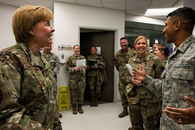 U.S. Air Force Brig. Gen. Sharon Bannister, Air Combat Command Surgeon General, left, laughs with U.S. Air Force Staff Sgt. Jadow Hughes, 325th Medical Support Squadron laboratory specialist, right, at Tyndall Air Force Base, Florida, Dec. 18, 2019. The lab had been severely undermanned for several months, mostly supported by civilian employees and Hughes, while they balanced operational needs and minimal staffing. (U.S. Air Force photo by Staff Sgt. Magen M. Reeves)