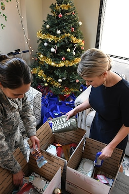 NELLIS AIR FORCE BASE, Nev. -- Eileen Collins and Staff Sgt. Julie Camacho, 926th Wing Airman and Family Readiness, prepare care packages for deployed 926th Wing members, Dec. 9, 2019, at Nellis Air Force Base, Nevada. (U.S. Air Force photo by Natalie Stanley)