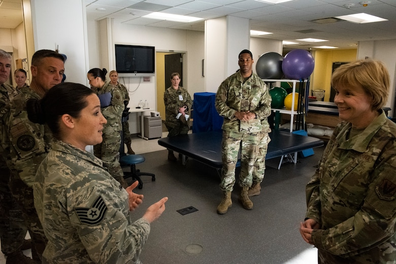 U.S. Air Force Tech. Sgt. Jody Smen, 325th Operational Medical Readiness Squadron, left, gives a capability briefing to U.S. Air Force Brig. Gen. Sharon Bannister, Air Combat Command Surgeon General, right, at Tyndall Air Force Base, Florida, Dec. 19, 2019. The 325th Medical Group had recently reopened the physical therapy department and resumed patient care in-house. (U.S. Air Force photo by Staff Sgt. Magen M. Reeves)
