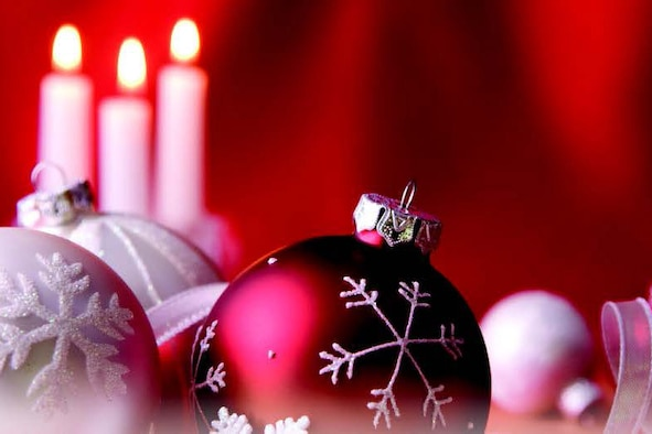 A photo of holiday ornaments and candles.