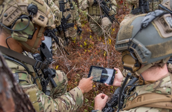 Members of the 6th Special Operations Squadron use a tablet to upload coordinates during an exercise showcasing the capabilities of the Advanced Battle Management System at Duke Field, Fla., Dec. 17, 2019. During the first demonstration of the ABMS, operators across the Air Force, Army, Navy and industry tested multiple real-time data sharing tools and technology in a homeland defense-based scenario enacted by U.S. Northern Command and enabled by Air Force senior leaders. The collection of networked systems and immediately available information is critical to enabling joint service operations across all domains. (U.S. Air Force photo by Tech. Sgt. Joshua J. Garcia)