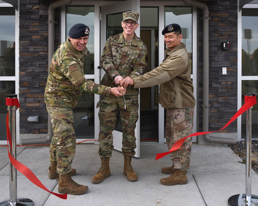 From left to right, Maj. Joseph Farinash, 460th Security Forces Squadron commander, Col. Trevor Wentlandt, 460th Mission Support Group commander, and Chief Master Sgt. Max Van Ausdal, 460th SFS security forces manager, cut the ribbon to signify the opening of the 460th Security Forces Combat Arms Training and Maintenance Facility at Buckley Air Force Base, Colo., Dec 19, 2019.