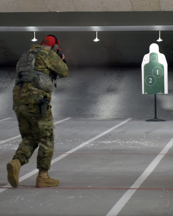 Staff Sgt. Britton Smith, 460th Security Forces Squadron combat arms instructor, demonstrates the capabilities of an M4 rifle at the 460th Security Forces Combat Arms Training and Maintenance Facility at Buckley Air Force Base, Colo., Dec. 19, 2019.