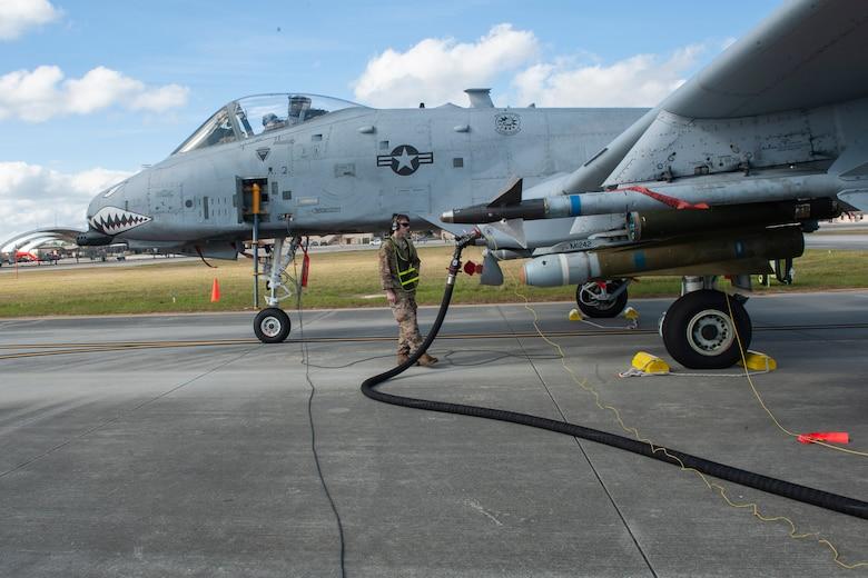 Photo of an Airman refueling an A-10C Thunderbolt II