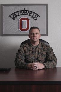 U.S. Marine Corps Capt. Richard A. Hayek, the 12th Marine Corps District adjutant, poses for a photo at his desk in San Diego, Calif., Dec. 19, 2019. Hayek was nominated for he award for various actions that exemplified leadership on and off the battlefield. (U.S. Marine Corps photo by Sgt. Christian Cachola)