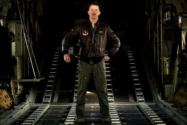 "Staff Sgt. Cody Carr, a Loadmaster Instructor assigned to the 130th Aerial Squadron, poses for a portrait in a C-130 Hercules on December 8, 2019 at McLaughlin Air National Guard Base, Charleston, W.Va. Carr was selected by his commander as the monthly ""Charlie West Spotlight"". (U.S. Air National Guard Photo by Senior Airman Caleb Vance)"