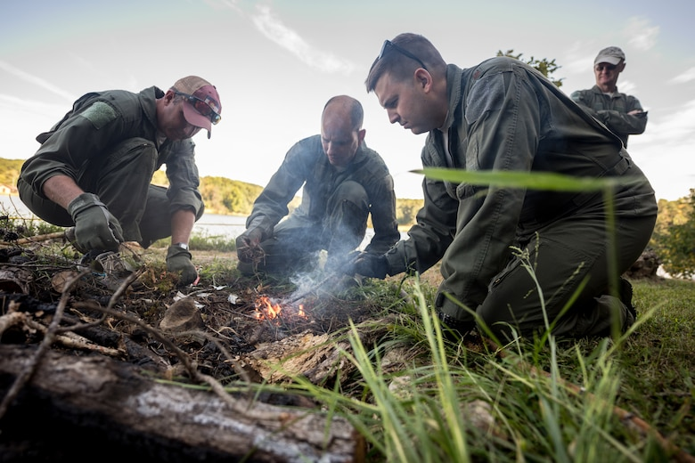 Aircrew members from the Kentucky Air National Guard's 123rd Airlift Wing build a fire during survival training at Camp Crooked Creek in Shepherdsville, Ky., Sept. 14, 2019. More than 60 aircrew members practiced land- and water-survival training here Sept. 13-15. (U.S. Air National Guard photo by Staff Sgt. Joshua Horton)