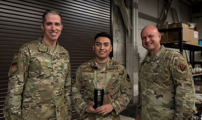 Airman stands with leadership