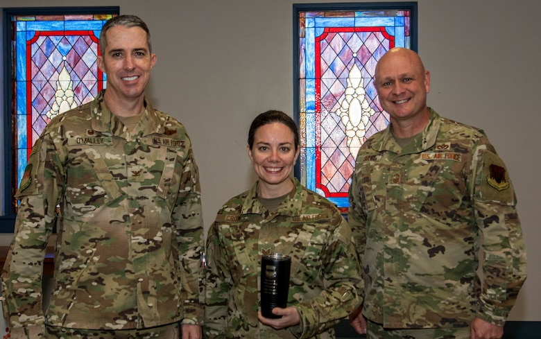 a photo of an Airman being awarded weasel of the week