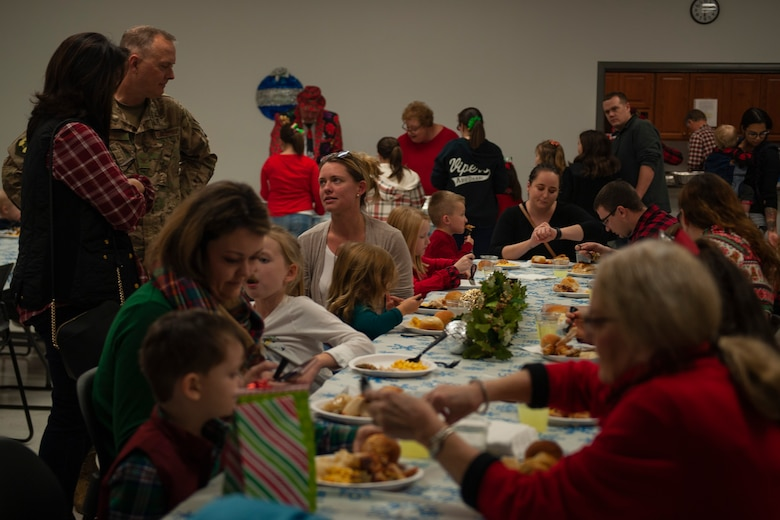 A photo of families at the Holiday Dinner