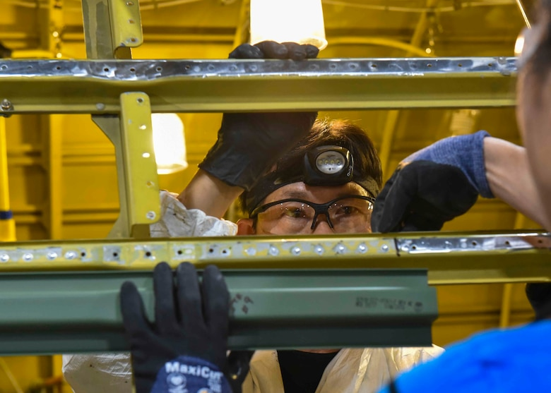 A 564th Aircraft Maintenance Squadron worker assists with programmed depot maintenance on a KC-135 Stratotanker at the Oklahoma City Air Logistics Complex on Tinker Air Force Base, Oklahoma, Nov. 23, 2019. Once PDM is complete, Airmen from the aircraft's home station tour the OC-ALC to discuss with the workers common defects they're experiencing with the aircraft. (U.S. Air Force photo by Airman Kiaundra Miller)