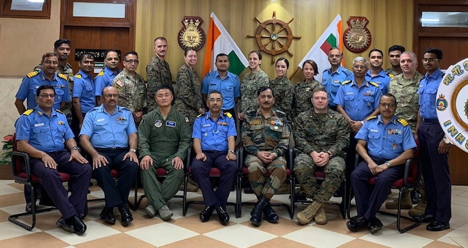 U.S. and Indian military service members pose for a group photo during a medical subject matter expert exchange at Indian Naval Hospital Kalyani, Visakhapatnam, India, Nov. 15, 2019. The SMEE focused on lessons learned and humanitarian assistance and disaster relief operations table top exercises in a post-disaster environment, where roads, air, and seaports are no longer accessible due to a natural disaster. (Courtesy photo)