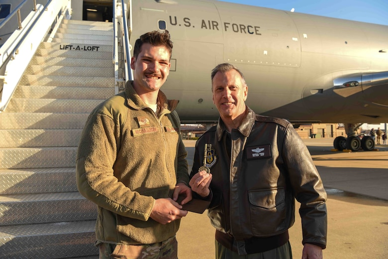 Staff Sgt. Ian Michaelson, 931st Aircraft Maintenance Squadron crew chief, hands Maj. Gen. Randall A. Ogden, 4th Air Force commander, the key of the aircraft, Dec. 20, 2019, at McConnell Air Force Base, Kan. The installation will be receiving 36 total KC-46A Pegasus aircraft. (U.S. Air Force photo by Airman 1st Class Alexi Bosarge)