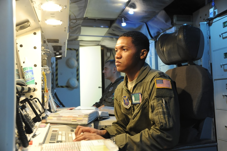 Capt. Javon Quarles, 321st Missile Squadron mission combat crew commander, responds to a message during his second alert as an individual mobilization augmentee. Quarles served 4 years on active duty with the 321st MS and transitioned into the Air Force Reserve earlier this year.  (U. S. Air Force photo by Glenn S. Robertson)