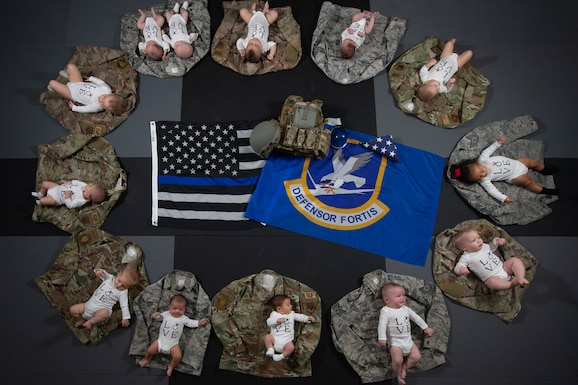 Thirteen babies lay on their parents uniforms Nov. 20, 2019, at Mountain Home Air Force Base, Idaho.