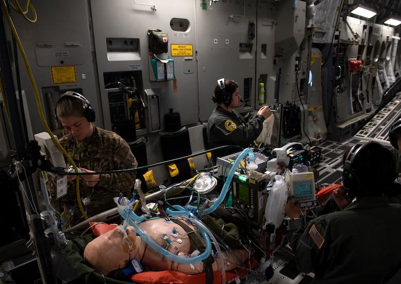 photos of Airmen practicing aeromedical evacuation on a C-17 Globemaster III from Travis AFB, California.