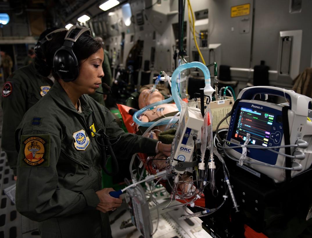 photos of Airmen practicing aeromedical evacuation on a C-17 Globemaster III from Travis AFB, California.