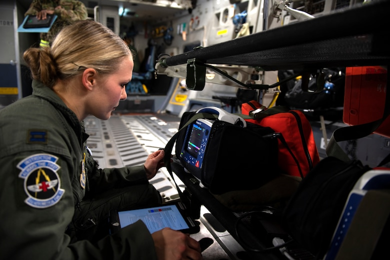 Photo of Airman practicing aeromedical evacuation on a C-17 Globemaster III from Travis Air Force Base, California.