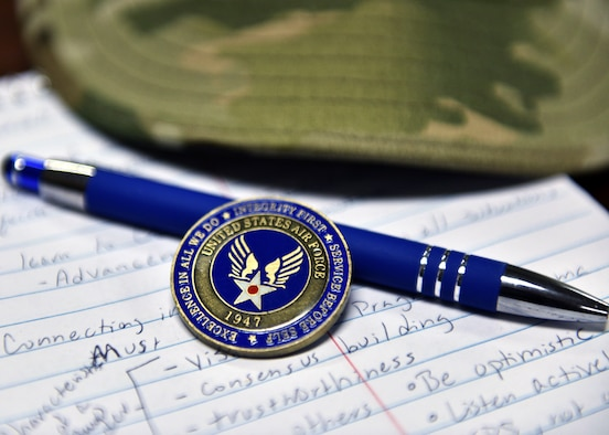 The Airman's coin is a tradition in recognition of taking the first step to becoming a leader in the U.S. Air Force. Following Basic Military Training, Airmen are challenged to take on leadership roles and become mentors to their peers. (U.S. Air Force photo by Airman 1st Class Robyn Hunsinger)