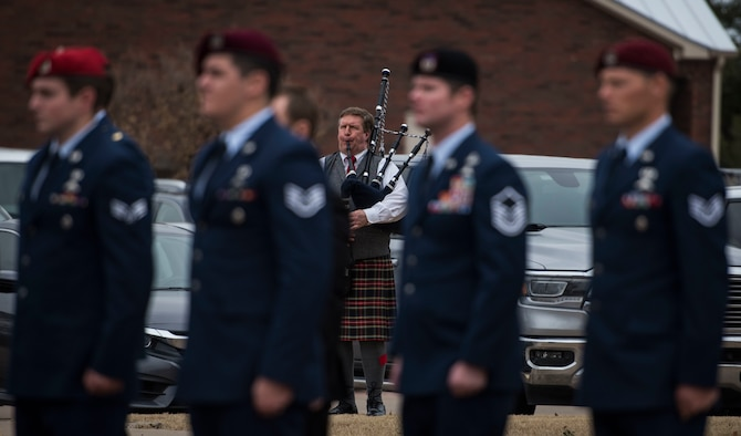 A piper plays taps during the military funeral honors of U.S. Air Force Staff Sgt. Cole Condiff, a Special Tactics combat controller, at the Church of Jesus Christ of Latter-day Saints, Richardson, Texas, Dec. 21, 2019. Condiff, assigned to the 23rd Special Tactics Squadron, Hurlburt Field, Florida, had an unplanned parachute departure from a C-130 aircraft Nov. 5, 2019, over the Gulf of Mexico. (U.S. Air Force photo by Senior Airman Rachel Williams)