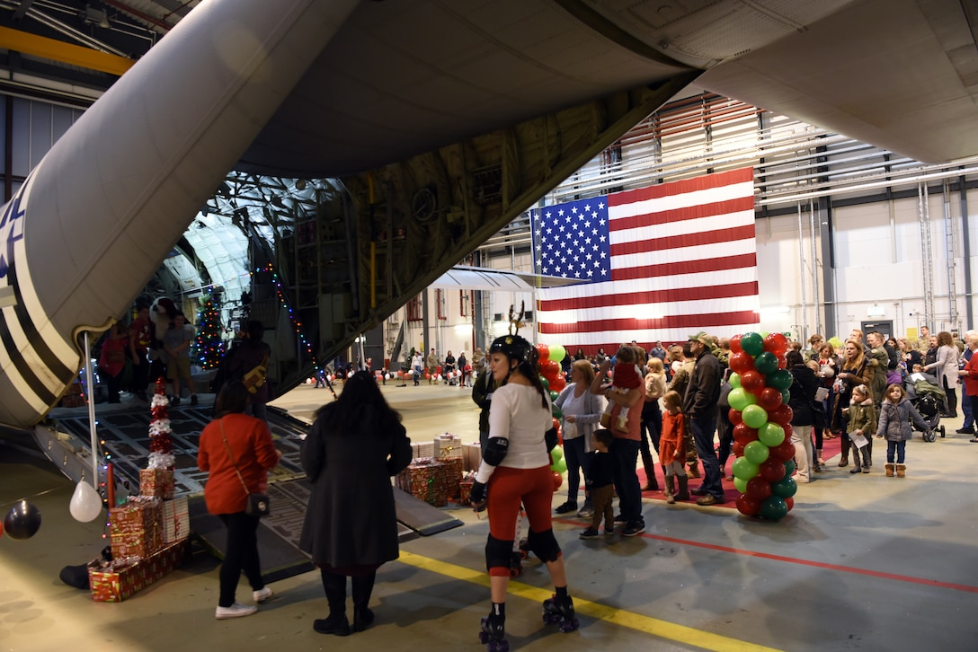 Families gather and wait in line to see Santaduring the Rudolph the Red Nosed Herc event at Ramstein Air Base, Germany, Dec. 20, 2019.