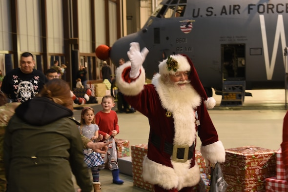 Santa greets and leads families around Rudolph the Red Nosed Herc during an event at Ramstein Air Base, Germany, Dec. 20, 2019.
