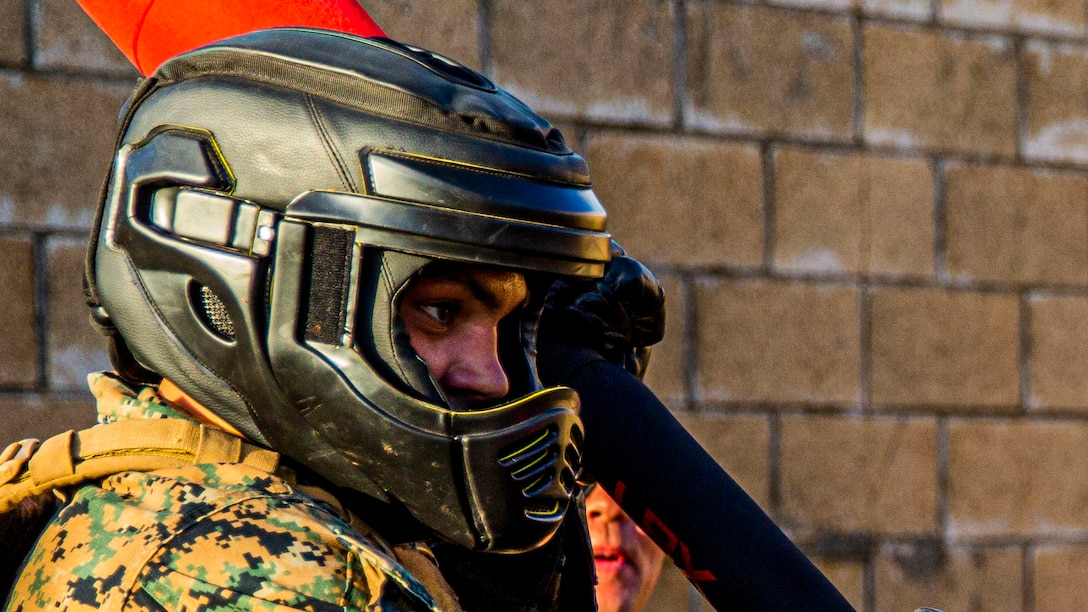 A U.S. Marine with 3rd Marine Regiment prepares for a pugil stick bout during a regimental squad competition on Marine Corps Base Hawaii, Dec. 19.