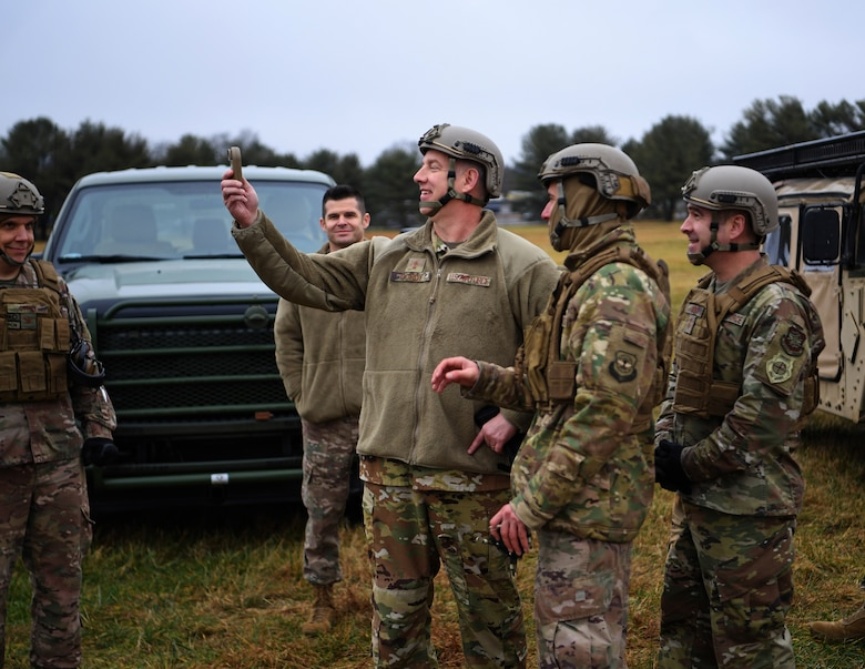 Maj. Gen. John Gordy (center), U.S. Air Force Expeditionary Center commander, handles a weather tracking tool at the Global Deployment Readiness Center Training Field, Joint Base McGuire-Dix-Lakehurst, New Jersey Dec. 17, 2019. Gordy spent the day with 621st Contingency Response Wing Airmen learning various aspects of the CRW mission. (U.S. Air Force photo by Tech. Sgt. Luther Mitchell)