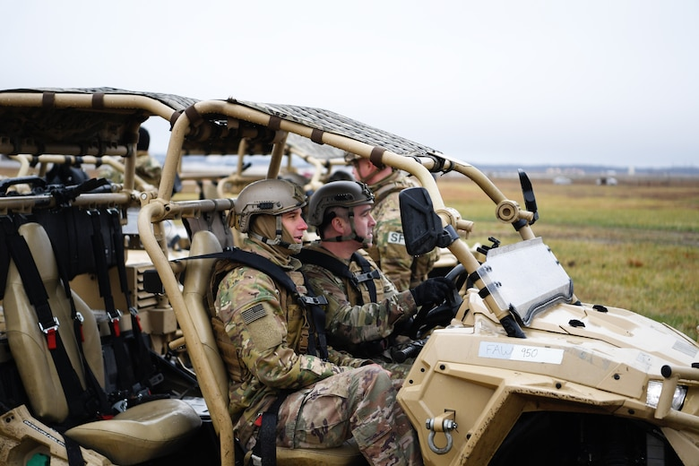 Chief Master Sgt. Kristopher Berg, U.S. Air Force Expeditionary Center command chief, operates a Polaris MRZR at the Global Deployment Readiness Center Training Field, Joint Base McGuire-Dix-Lakehurst, New Jersey Dec. 17, 2019. Gordy along with Chief Master Sgt. Kristopher Berg, USAF EC command chief, spent the day learning about the CRW mission. (U.S. Air Force photo by Tech. Sgt. Luther Mitchell)