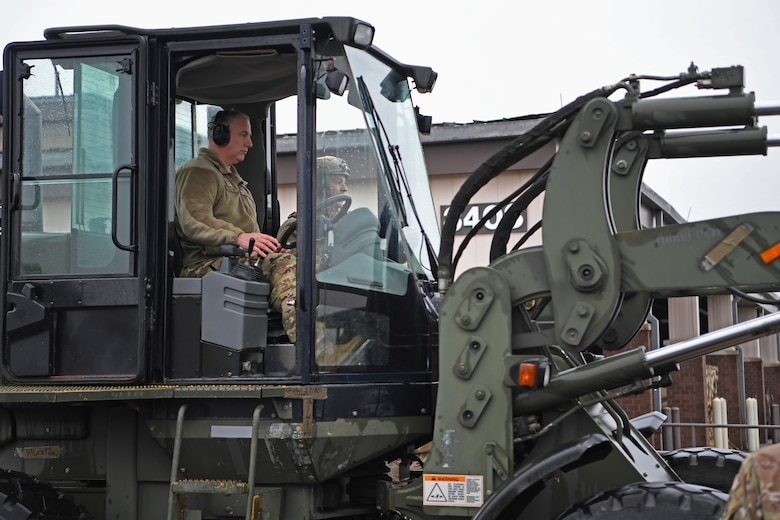 Maj. Gen. John Gordy, U.S. Air Force Expeditionary Center commander, operates a 10K All Terrain forklift at the Global Deployment Readiness Center, Joint Base McGuire-Dix-Lakehurst, New Jersey Dec. 17, 2019. Gordy spent the day with 621st Contingency Response Wing Airmen learning various aspects of the CRW mission. (U.S. Air Force photo by Tech. Sgt. Luther Mitchell)