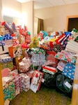 Room full of gifts for Holiday giving