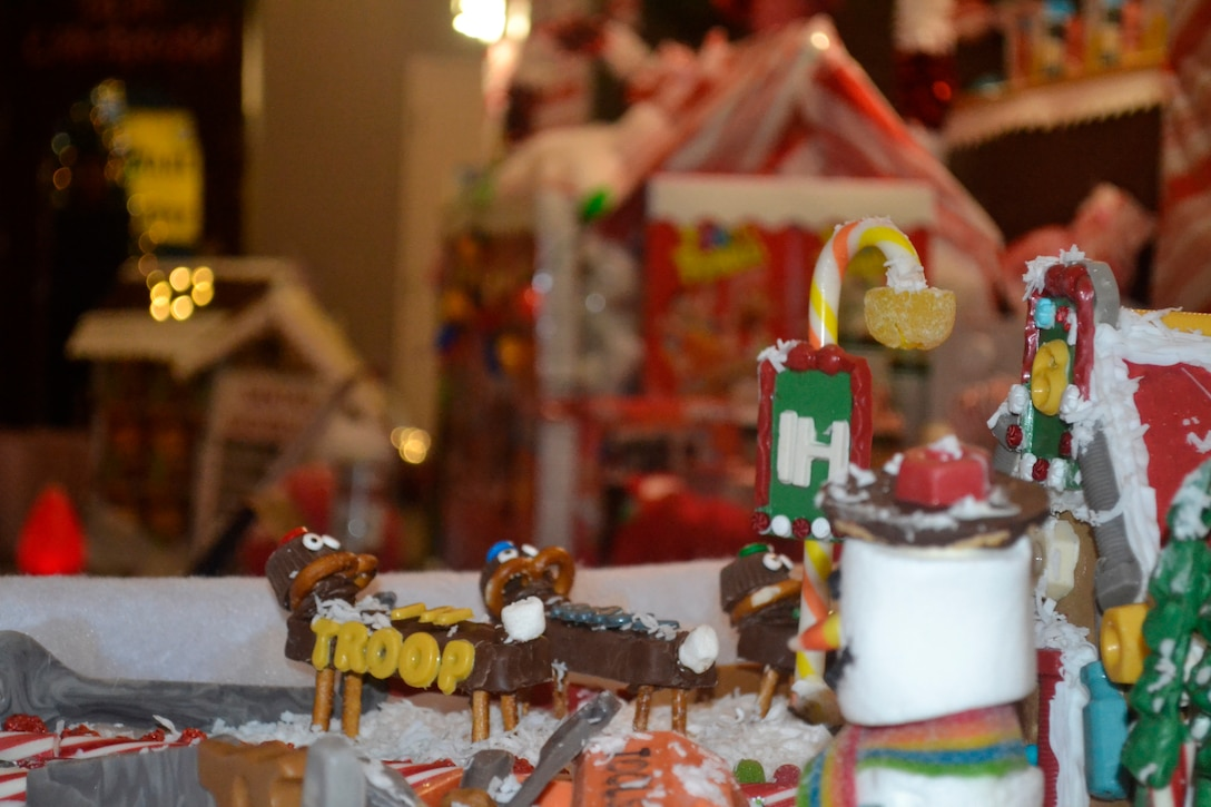 A gingerbread house sits at the edge of a winter village constructed by employees at DLA Troop Support's Industrial Hardware supply chain in Philadelphia Dec. 20, 2019 as part of a holiday decorating contest.