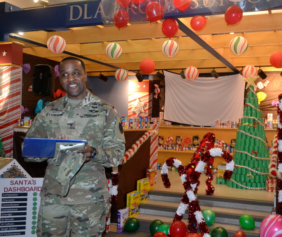 DLA Troop Support Commander Army Brig. Gen. Gavin Lawrence addresses employees from the Industrial Hardware supply chain in Philadelphia Dec. 20, 2019 during the judging of this year's holiday decorating contest.