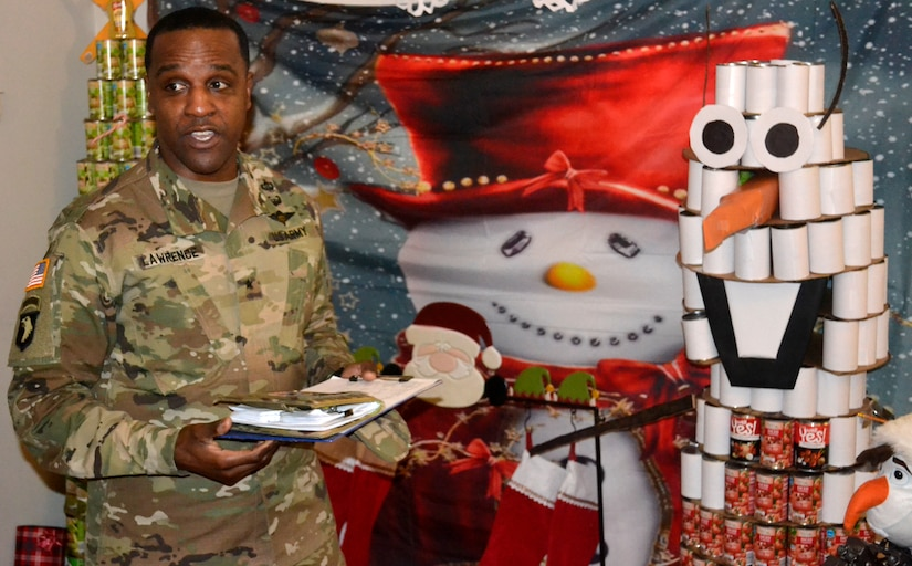 DLA Troop Support Commander Army Brig. Gen. Gavin Lawrence addresses employees from the Medical supply chain Dec. 20, 2019, in Philadelphia during the judging of this year's holiday decorating contest.
