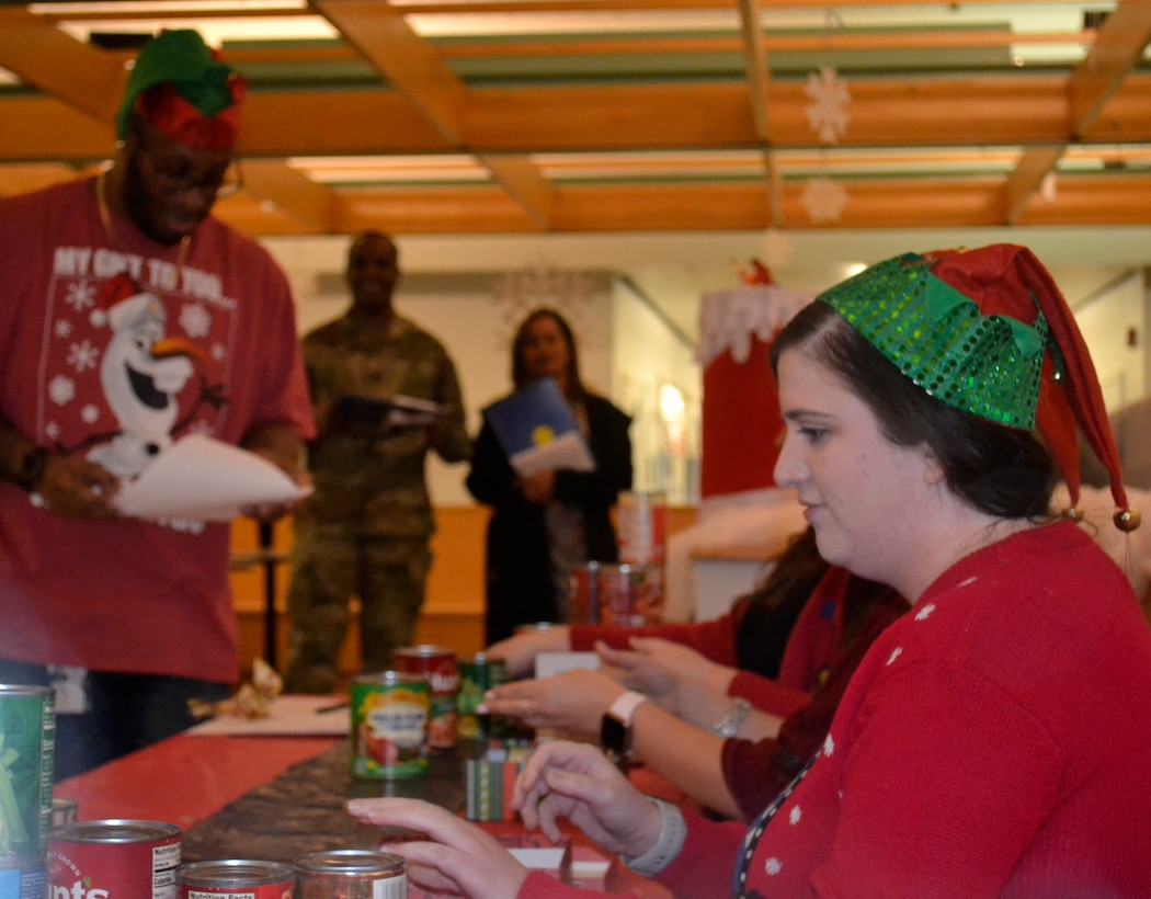 DLA Troop Support employees from the Clothing and Textiles supply chain perform a skit preparing items for Santa Claus to deliver to those in need during the annual Troop Support holiday decorating contest Dec. 20, 2019, in Philadelphia.