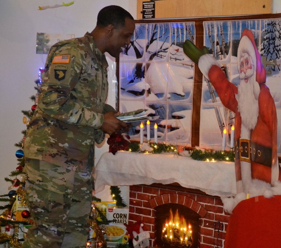 DLA Troop Support Commander Army Brig. Gen. Gavin Lawrence inspects the Construction and Equipment supply chain's decorations for the judging of this year's holiday decorating contest Dec. 20, 2019, in Philadelphia.
